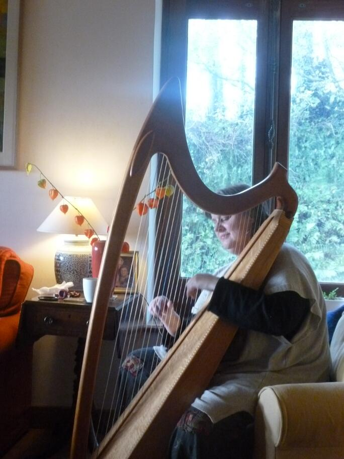 Abigail playing the harp
